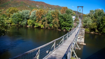 The Buchanan Swinging Bridge is 366 feet long, 57.5 feet tall, the only one of its type to cross the James River. Portions of the large stone piers were constructed in 1851 for the Buchanan Turnpike Company's Toll Bridge (fice cents per person and additional five cents for each horse, mule, oxen or wagon). This version of the bridge was built in 1937. Virginia Tourism Corporation, www.Virginia.org